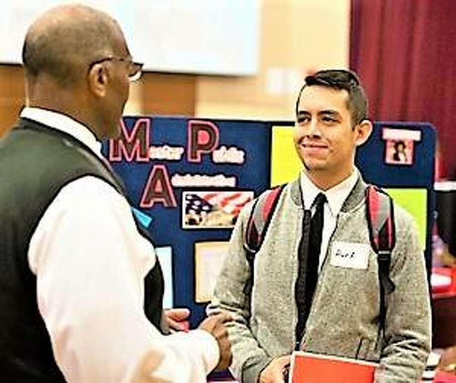 Alan Ayala, of Springfield, met with Morris Taylor, PhD, associate professor and chair of the public administration and policy analysis program, during SIUE's Graduate School Open House.