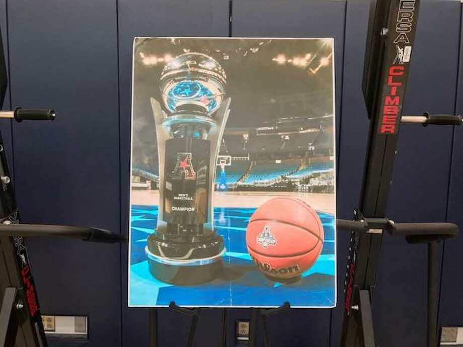 A picture of the AAC championship trophy follows UConn players to practices, weight room, etc. as a form of motivation. Photo: David Borges / Hearst Connecticut Media