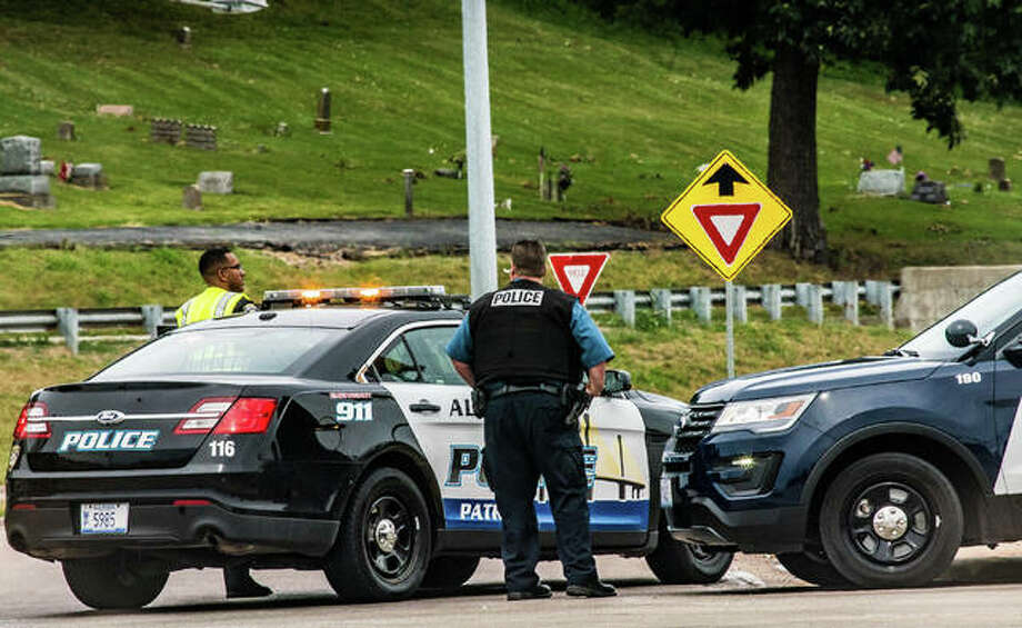 Alton police officers close the northbound lanes of the Homer Adams Parkway extension at East Broadway Saturday while investigators process the scene of a fatal motorcycle crash. Photo: Nathan Woodside | The Telegraph