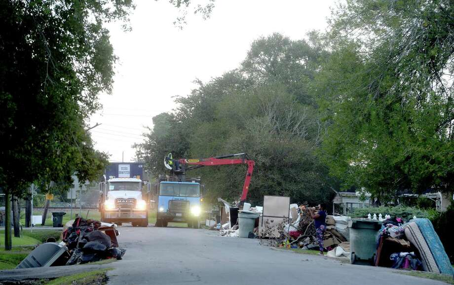 Crews with the City of Beaumont Solid Waste blanketed the neighborhood surrounding Fehl - Price Elementary early Saturday morning as they continue the large debris pick-up from homes and businesses gutted after flooding during Imelda last week. Photo taken Saturday, September 28, 2019 Kim Brent/The Enterprise Photo: Kim Brent / The Enterprise / BEN