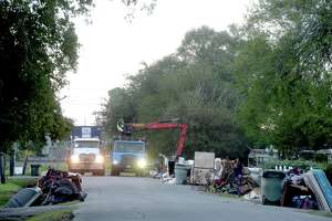 Crews with the City of Beaumont Solid Waste blanketed the neighborhood surrounding Fehl - Price Elementary early Saturday morning as they continue the large debris pick-up from homes and businesses gutted after flooding during Imelda last week. Photo taken Saturday, September 28, 2019 Kim Brent/The Enterprise