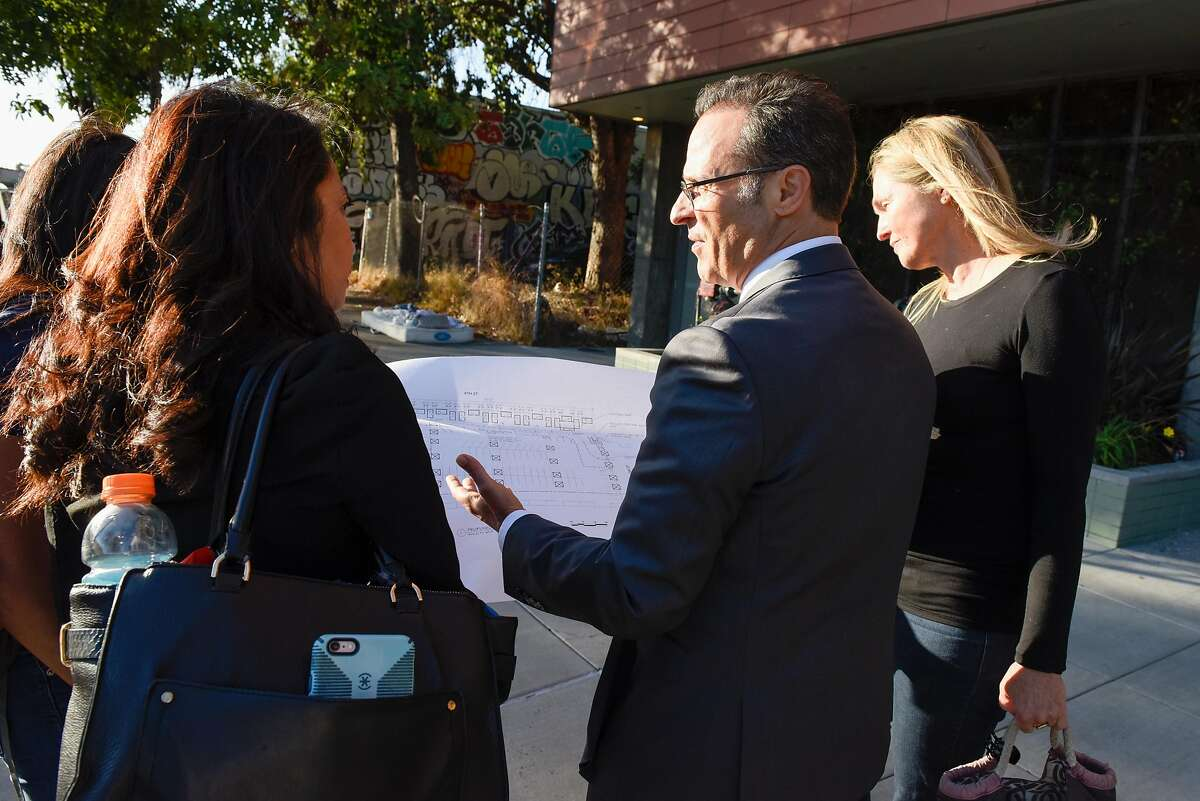 Stacey Foster Martz, Kris Vann, Joe DeVries, Assistant to the City Administrator for the City of Oakland, and Jen McCune outside one of the community cabin sites in Oakland, Calif., on September 20, 2019.