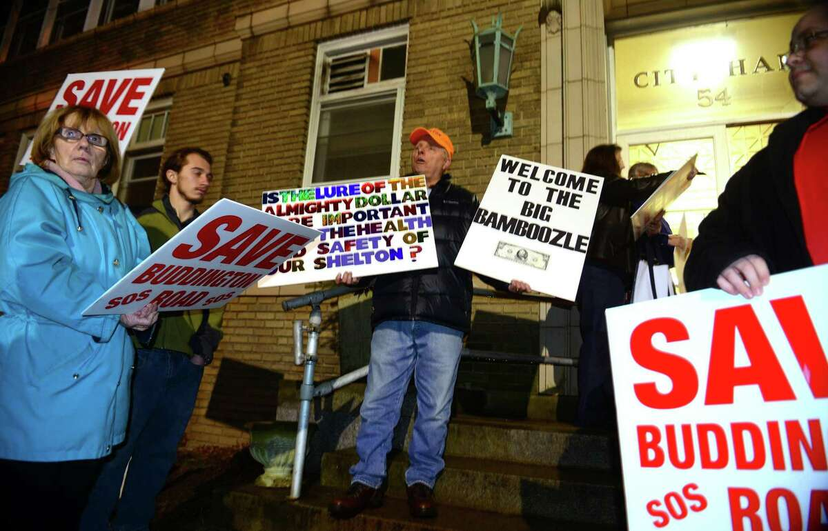 FILE PHOTO: Resident Jim Jansson, center, stands with other members of Save Our Shelton outside before attending the Shelton Planning and Zoning commission meeting at Shelton City Hall in Shelton, Conn., on Friday May 6, 2016.