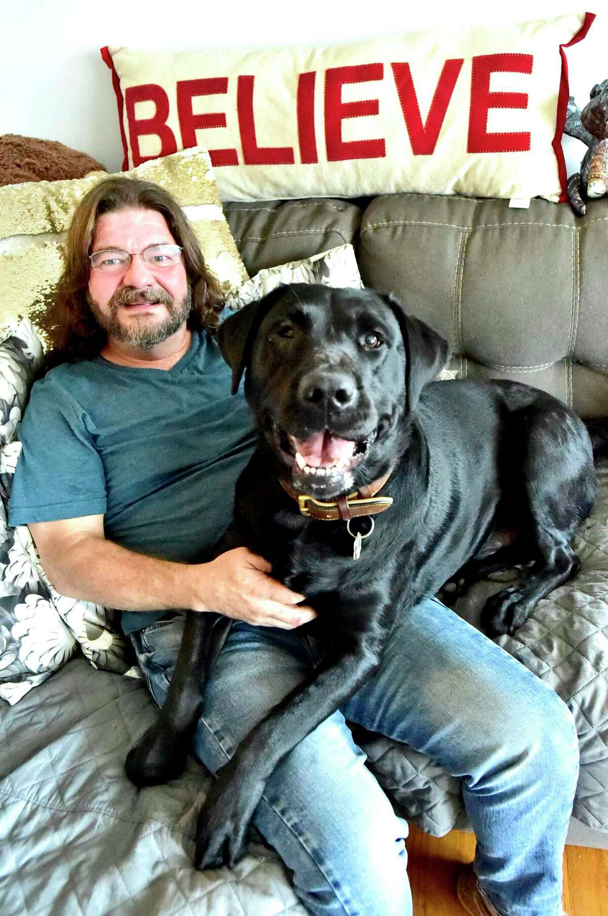 John Seymour of East Haven, who was sexually abused by three priests, with his Labrador retriever Chip.