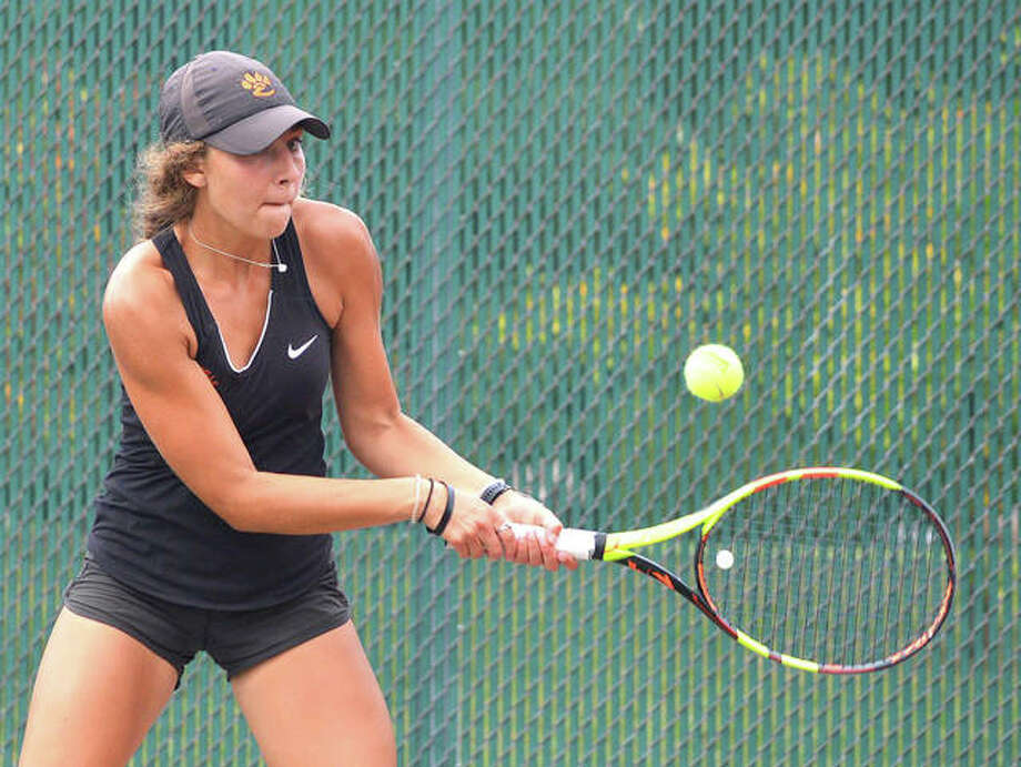 Edwardsville's Hayley Earnhart makes a backhand return during her No. 6 singles match against Triad's Kyle Triplo Wells on Saturday during the Southern Illinois Duals at the EHS Tennis Center. Photo: Scott Marion/The Intelligencer