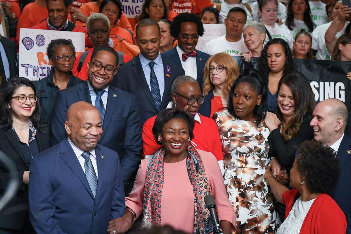 Senate Majority Leader Andrea Stewart-Cousins, D-Yonkers, center, and Speaker of the Assembly Carl Heastie, D-Bronx, left, following the passage of laws governing how landlords treat tenants. (Courtesy of The New York State Senate)