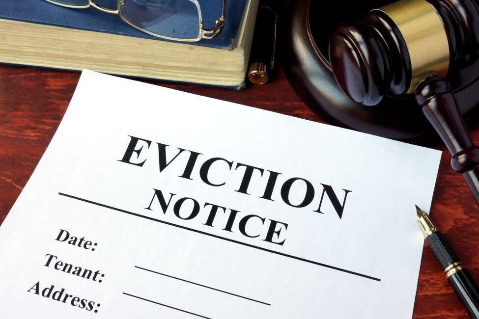 Eviction notice and gavel on a table.