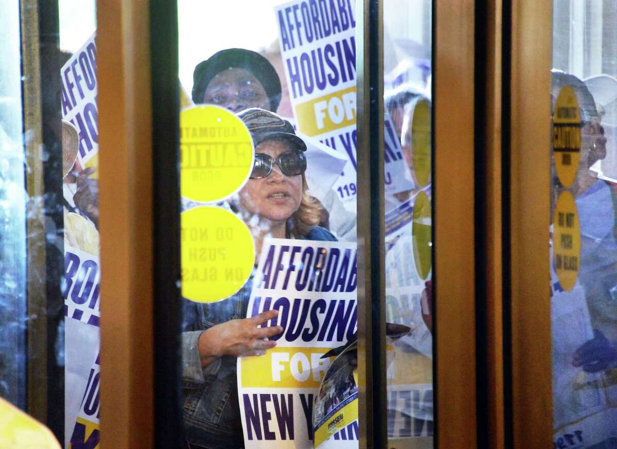 Efforts to change the laws around renting and landlord-tenant relationships have been ongoing. Demonstrators waiting at the doors of the Capitol to rally for rent laws are shown here in June, 2015 in Albany. (John Carl D'Annibale / Times Union)
