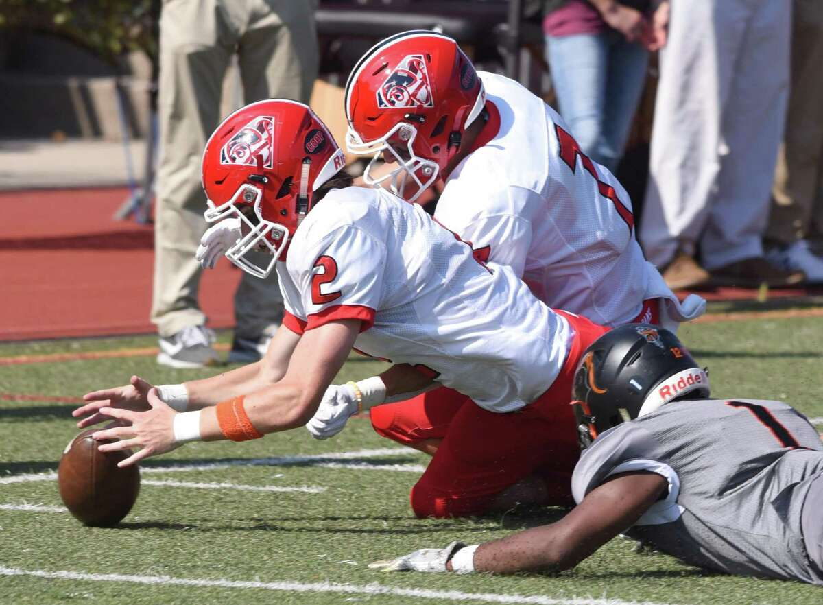 New Canaan's Jack Finnigan (2) dives to recover a Stamford fumble during a football game at Boyle Stadium in Stamford on Saturday, Sept. 28, 2019.