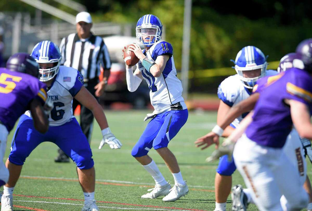 Darien quarterback Peter Graham stays in the pocket looking for a receiver in an FCIAC football game against Westhill at Westhill High School's J. Walter Kennedy Stadium on Sept. 28, 2019 in Stamford, Connecticut.