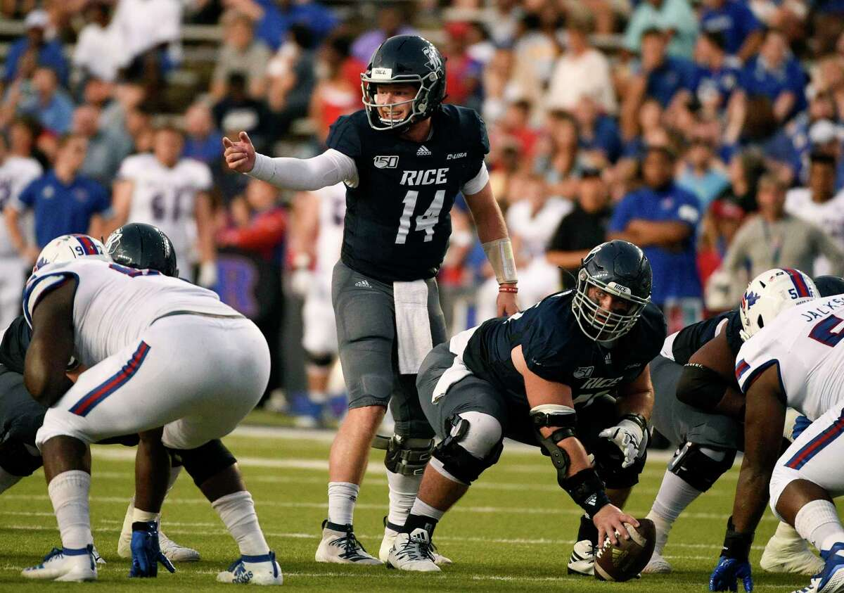 Rice quarterback Tom Stewart (14) yells instructions at the line of scrimmage during the first half of an NCAA college football game against Louisiana Tech, Saturday, Sept. 28, 2019, in Houston.