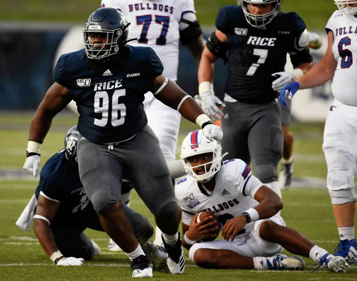 Rice defensive tackle De'Braylon Carroll (96) celebrates his sack of Louisiana Tech quarterback J'Mar Smith, bottom right, during the first half of an NCAA college football game, Saturday, Sept. 28, 2019, in Houston.