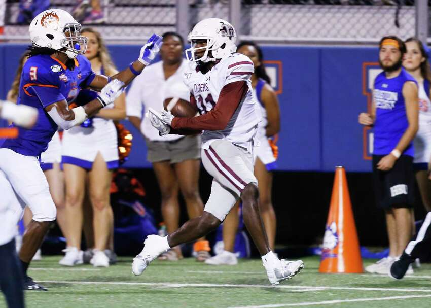 Texas Southern Tigers wide receiver Tren'Davian Dickson (11) catches a pass for a touchdown over Houston Baptist Huskies cornerback Alfred King (3) in the second quarter of game action on Saturday, Sept. 28, 2019 in Houston.