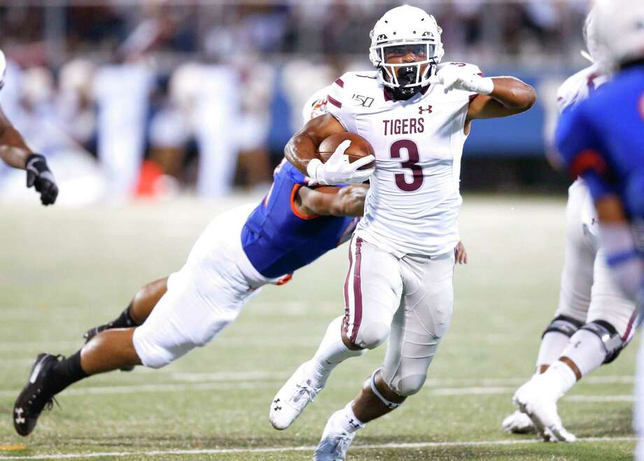 Texas Southern Tigers running back Tylor Cook (3) avoids being taken down by Houston Baptist Huskies linebacker Jeremy Ardoin (41) on Saturday, Sept. 28, 2019 in Houston. Photo: Elizabeth Conley, Staff Photographer / © 2018 Houston Chronicle