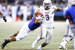 Texas Southern Tigers running back Tylor Cook (3) avoids being taken down by Houston Baptist Huskies linebacker Jeremy Ardoin (41) on Saturday, Sept. 28, 2019 in Houston.