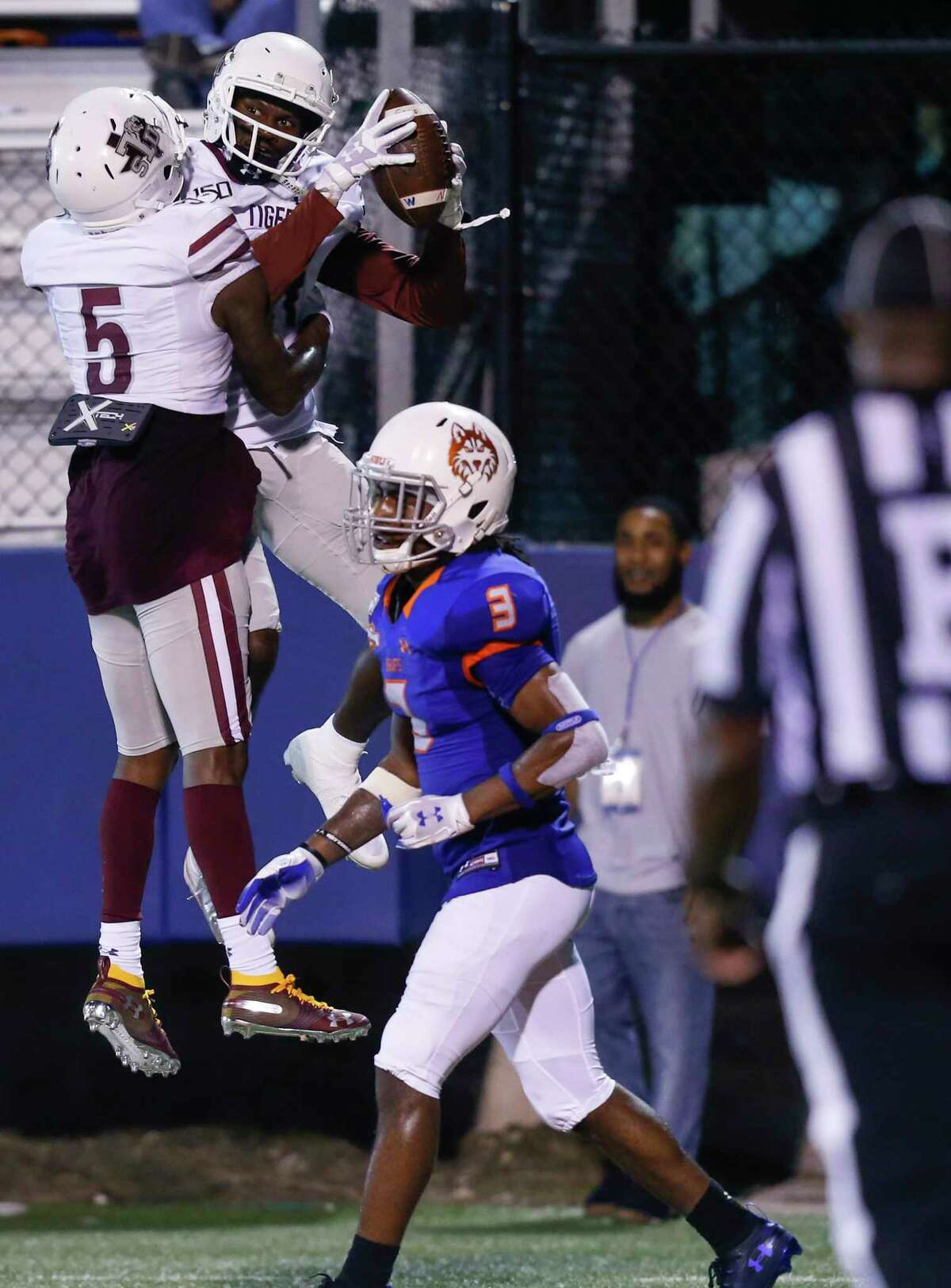 Texas Southern Tigers wide receiver Tren'Davian Dickson (11) celebrates his touchdown with teammate Thurman Morbley (5) on Saturday, Sept. 28, 2019 in Houston.