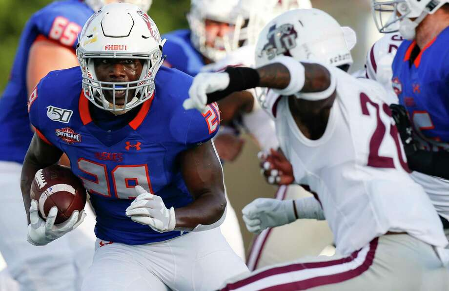 Houston Baptist Huskies running back Dreshawn Minnieweather (28) keeps on his feet as he runs the ball into the end zone against Texas Southern Tigers on Saturday, Sept. 28, 2019 in Houston. Photo: Elizabeth Conley, Staff Photographer / © 2018 Houston Chronicle