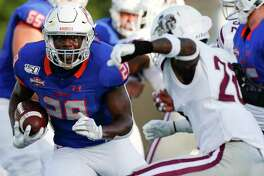 Houston Baptist Huskies running back Dreshawn Minnieweather (28) keeps on his feet as he runs the ball into the end zone against Texas Southern Tigers on Saturday, Sept. 28, 2019 in Houston.