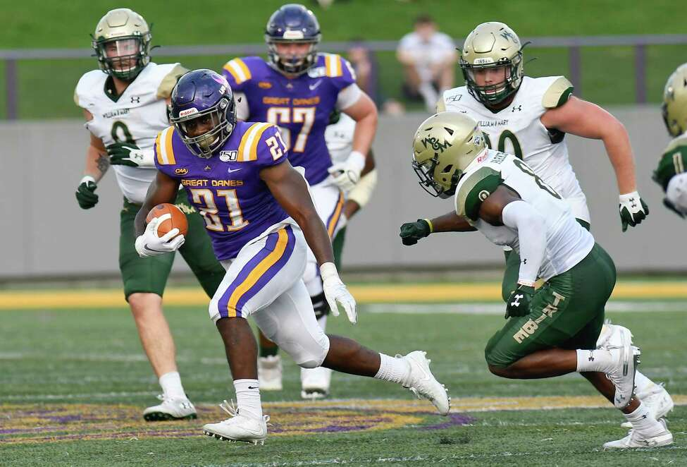University at Albany's Karl Mofor (21) runs with the ball against William & Mary during the first half of an NCAA college football game Saturday, Sept. 28, 2019, in Albany, N.Y.