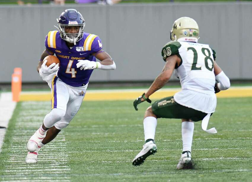 University at Albany's Juwan Green (4) runs with the ball in front of William & Mary's Latrelle Smith (28) during thesecond half of an NCAA college football game Saturday, Sept. 28, 2019, in Albany, N.Y.