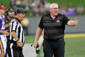 University at Albany head coach Greg Gattuso questions a call by an official while playing William & Mary during the second half of an NCAA college football game Saturday, Sept. 28, 2019, in Albany, N.Y.