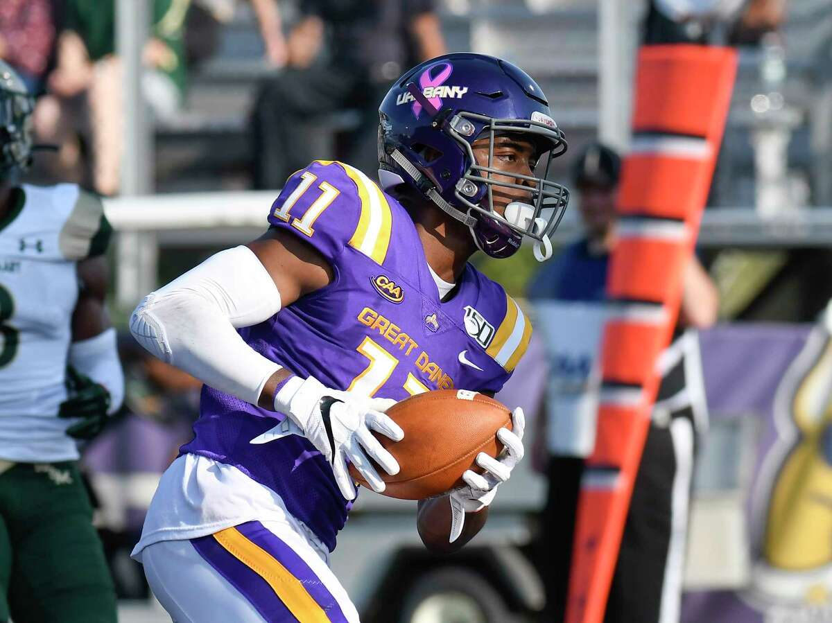 University at Albany's Jerah Reeves (11) scores a touch down against William & Mary during the first half of an NCAA college football game Saturday, Sept. 28, 2019, in Albany, N.Y.