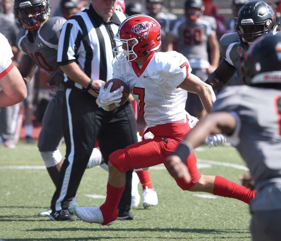 New Canaan's Zach LaPolice (7) cuts through the Stamford defense during a football game between New Canaan and Stamford at Boyle Stadium in Stamford on Saturday, Sept. 28, 2019. Photo: Dave Stewart / Hearst Connecticut Media / Hearst Connecticut Media