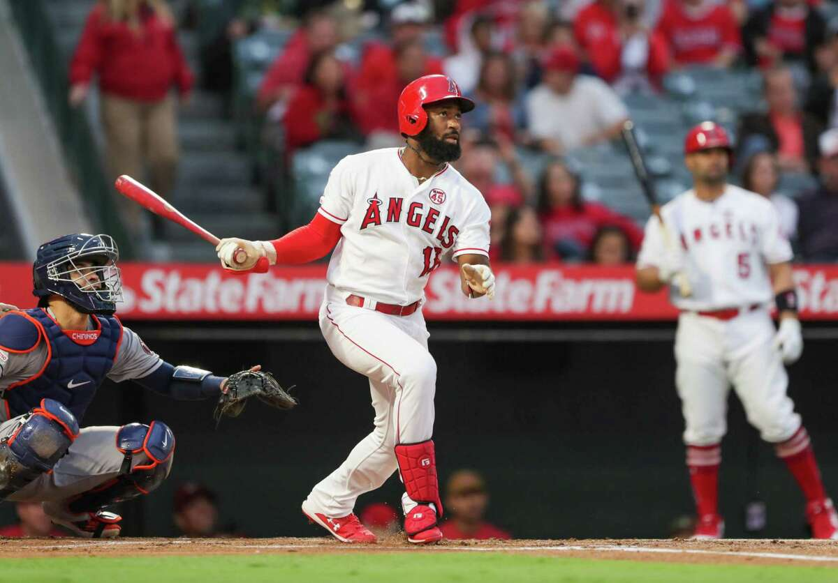 ANAHEIM, CALIFORNIA - SEPTEMBER 28: Brian Goodwin #18 of the Los Angeles Angels hits a home run in the 1st inning against the Houston Astros at Angel Stadium of Anaheim on September 28, 2019 in Anaheim, California.