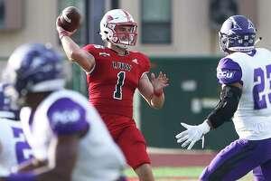 Cardinal quarterback Jon Copeland picks a receiver over the pash rush as UIW hosts Abilene Christian University at Benson Stadium on Sept. 28, 2019.
