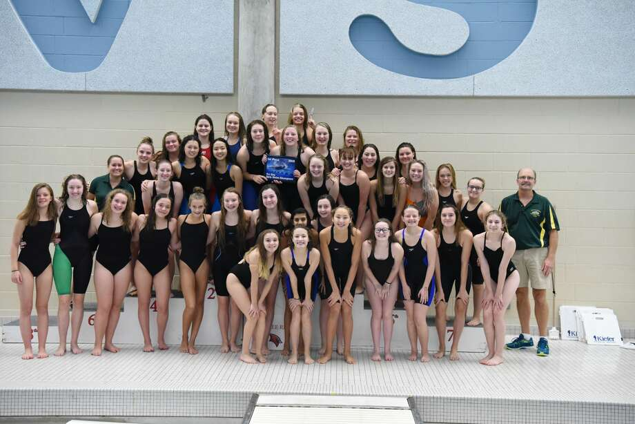 Dow High's team poses with the first-place plaque after winning the Tri-Cities Swimming & Diving Championship at SVSU on Saturday. Photo: Photo Provided