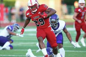 Cardinal running back Keyondrick Philio escapes some pursuers up the middle as UIW hosts Abilene Christian University at Benson Stadium on Sept. 28, 2019.