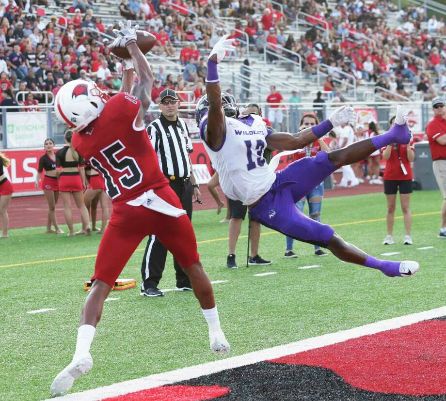 Cardinal receiver Jaelin Campbell pulls in a pass over Adonis Davis trying to stay in bounds in the end zone as UIW hosts Abilene Christian University at Benson Stadium on Sept. 28, 2019. Campbell couldn't make the play with his momentum taking him out of bounds. Photo: Tom Reel, Staff / Staff Photographer / 2019 SAN ANTONIO EXPRESS-NEWS