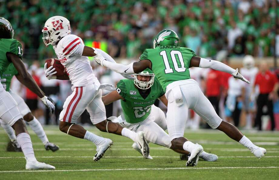 Houston's Bryson Smith, left, leaves North Texas' Makyle Sanders (10) and Nate Durham behind on a 60-yard punt return for a touchdown early in the fourth quarter of Saturday's game. Photo: Kara Dry, Staff Photographer / DRC / Kara Dry/Denton Record-Chronicle