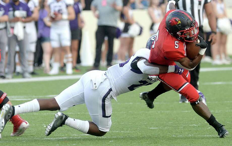 Lamar's Myles Wanza runs the ball as Stephen F. Austin's Gerard McKnight dives for the tackle during the homecoming game game Saturday. Photo taken Saturday, September 28, 2019 Kim Brent/The Enterprise Photo: Kim Brent / The Enterprise / BEN