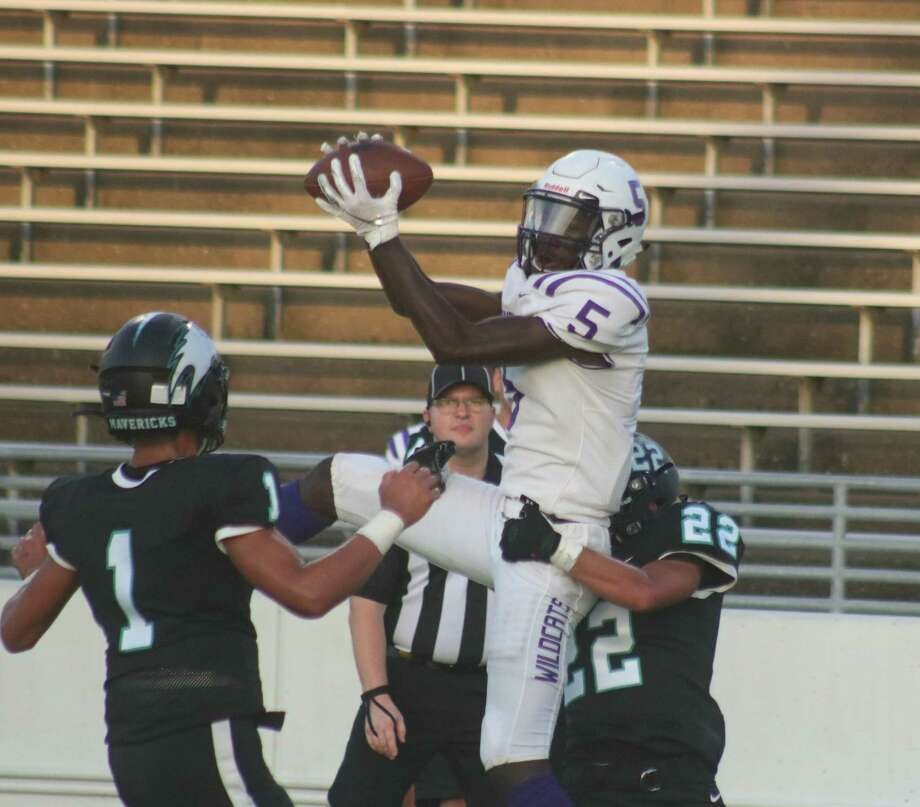 Humble receiver Robert Williams (5) leaps up for what appears to be a TD grab, but Williams lost the handle on the ball. On defense is Jordan See and Bryan Martinez. Photo: Robert Avery