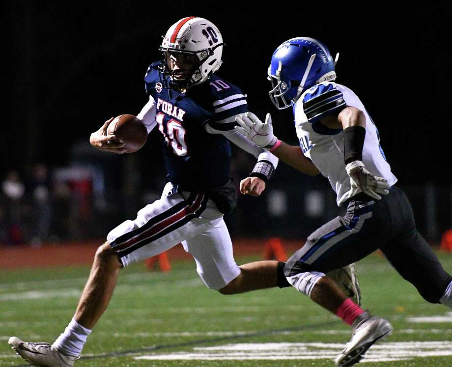 Foran's Andrew Janik had 294 yards of total offense in the Lions' opener with East Haven. Photo: David G. Whitham / For Hearst Connecticut Media / DGWPhotography