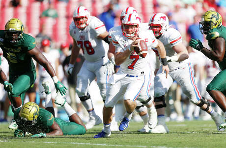 Southern Methodist Mustangs quarterback Shane Buechele (7) runs the ball during the second quarter against the USF Bulls on Saturday, Sept. 28, 2019 at Raymond James Stadium in Tampa, Fla. Southern Methodist Mustangs defeated the USF Bulls 48-21.