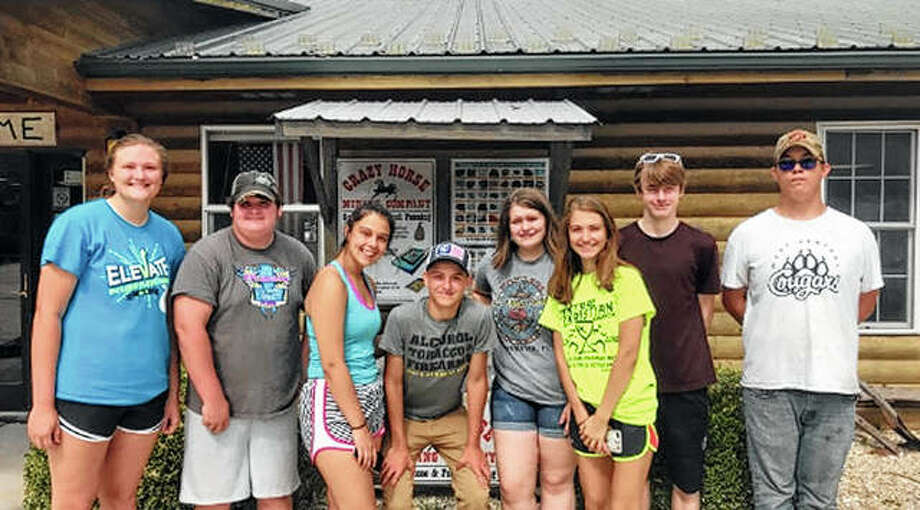 Members of the Bluffs FFA officer team used part of their summer to prepare for the year ahead, participating in a retreat at Crazy Horse Campground in Ashland. They used the retreat as a chance to plan the club's year, fish, kayak and bond around the fire with s'mores. Those attending included Morgan Hoots (from left), Triston Preston, Kaydence Gregory, Coby Zimmerman, Madison Hopkins, Alexis Bruns, Ethan Buhlig and Levi Haverfield. Photo: Photo Provided