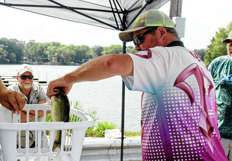 Jeff Jones of South Roxanna weighs his bass Saturday during the Bassin' for the Brave tournament at Lake Jacksonville. Photo: Samantha McDaniel-Ogletree | Journal-Courier