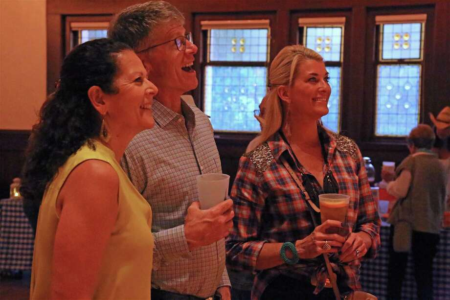 Enjoying there time are, from left, Janet and John Garrison, and Olivia Charney, all of Southport, at the Southport Trinity Church's Boots & BBQ Bash on Saturday, Sept. 28, 2019, at Pequot Library in Fairfield, Conn. Photo: Jarret Liotta / Jarret Liotta / ©Jarret Liotta