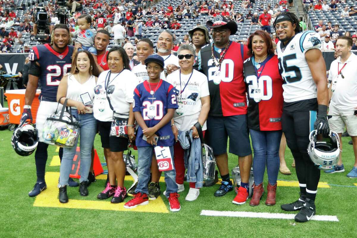The Reid family wearing dueling jerseys for their sons Houston Texans strong safety Justin Reid (20) and Carolina Panthers strong safety Eric Reid (25) before the start of an NFL football game at NRG Stadium on Sunday, Sept. 29, 2019, in Houston.