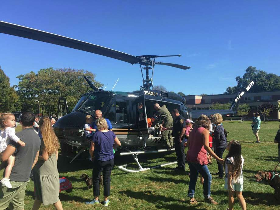 Visitors take a close look at Eagle One during the Ridgefield Police Department's Safety Day Sunday, Sept. 29. Photo: Steve Coulter / Hearst Connecticut Media