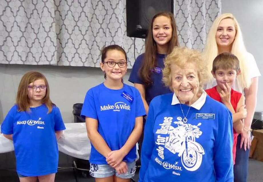 Norma Glazebrook stands with Wish children — Jessica, Gabby, Alivia, Glazebrook, Jaxson and Alexis — who thanked participants in the sixth annual Ride for Wishes on Sept. 21 for helping make their wishes come true. The event raised $27,000.