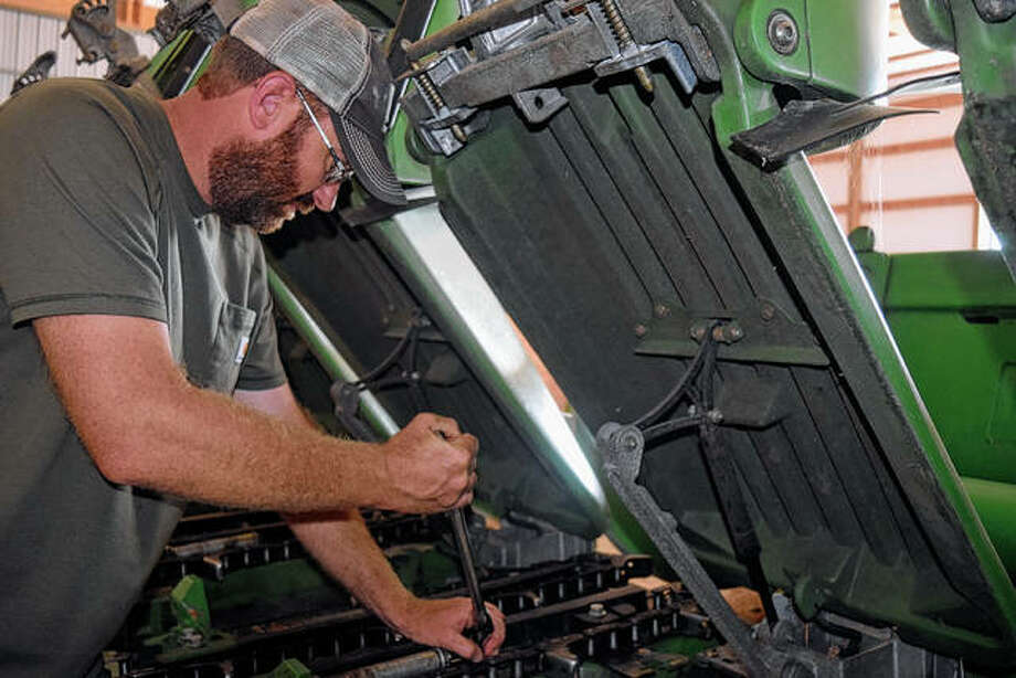 Doug Coop works on equipment in preparation for the fall harvest. Photo: Samantha McDaniel-Ogletree | Journal-Courier