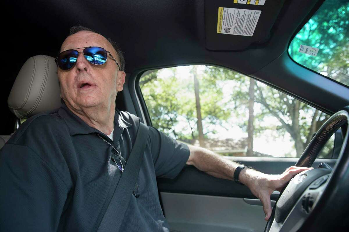 Rick Fritz, of Meyerland Citizen Patrol, checks on a house in the neighborhood on Thursday, Sept. 26, 2019, in Houston. Fritz is a volunteer leader who drives around and patrols the Meyerland neighborhood looking for signs of trouble.