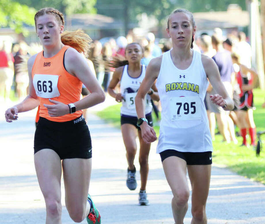 Roxana's Janelynn Wirth (right) runs with Mount Vernon's Summer Chelf midway through the Granite City Invite on Sept. 7. Wirth finished fifth in the race, with Chelf in 13th. On Saturday, Wirth finished first at the Freeburg Invite. Photo: Greg Shashack / The Telegraph