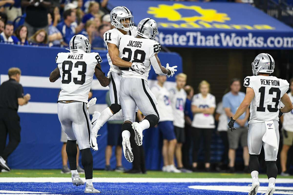 Oakland Raiders wide receiver Trevor Davis (11) celebrates a touchdown running back Josh Jacobs (28) during the first half of an NFL football game in Indianapolis, Sunday, Sept. 29, 2019. (AP Photo/Doug McSchooler)