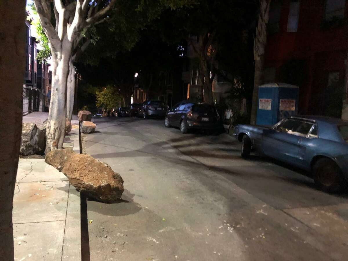 Several of the boulders placed in a San Francisco alley as a way to deter homeless encampments and drug dealing were rolled back into the street by early Sunday.