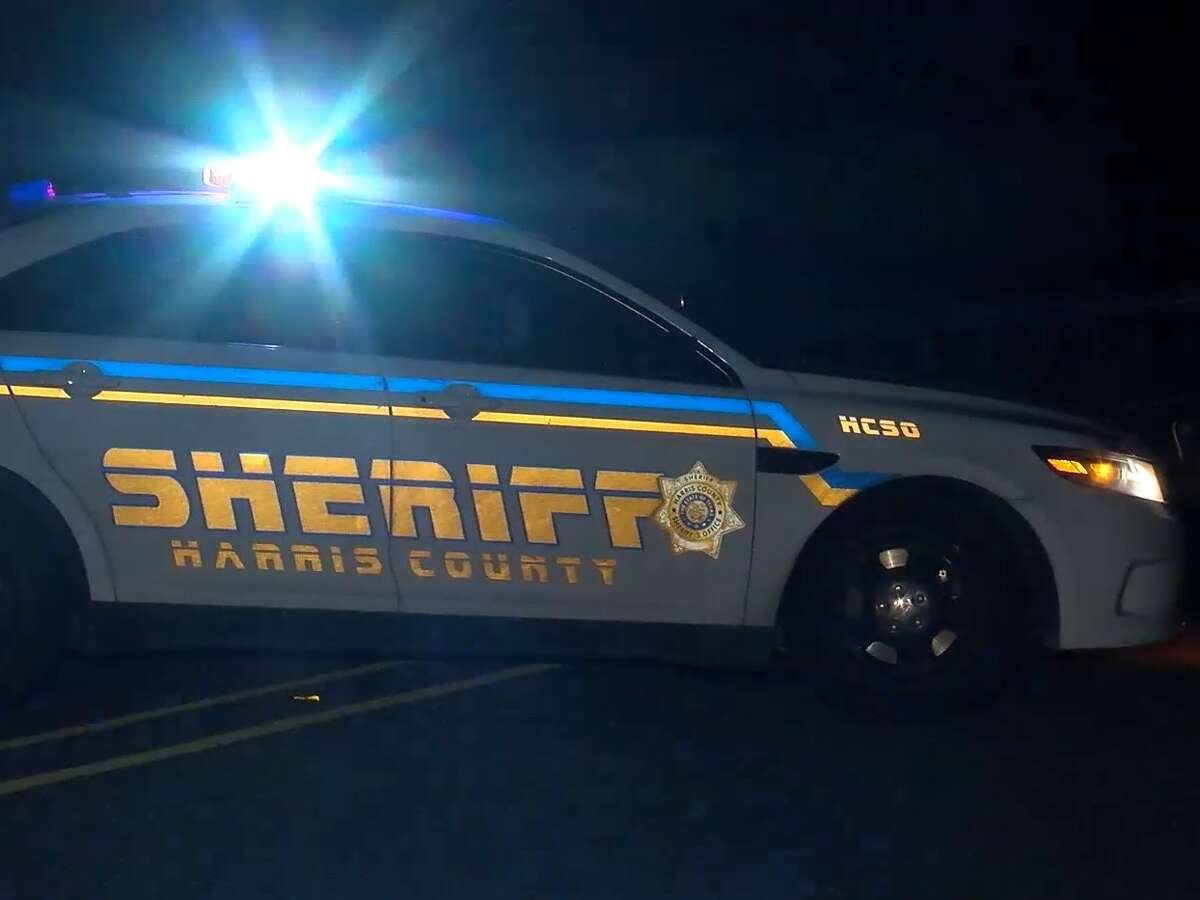 Authorities are investigating how a woman got hit by a pickup truck while walking along a rural highway in northeast Harris County.