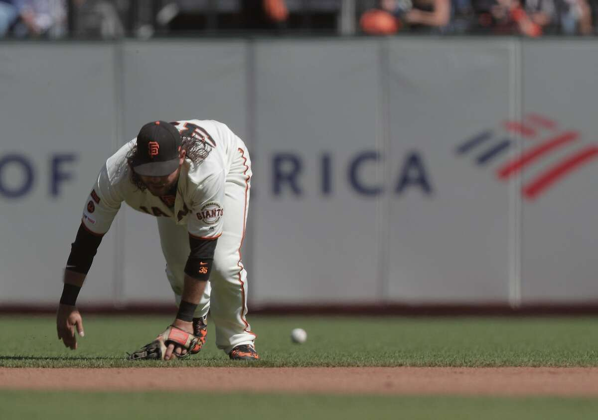 Brandon Crawford (35) can't get to a ball hit up the middle in the second inning as Bruce Bochy managed his final game with the San Francisco Giants at Oracle Park in San Francisco, Calif., on Sunday, September 29, 2019.